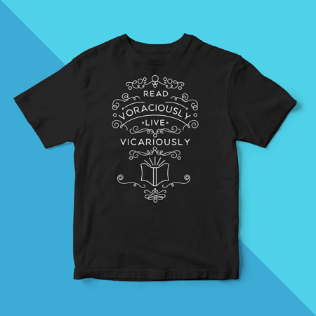 """T-Shirt: """"read voraciously, live vicariously""""."""