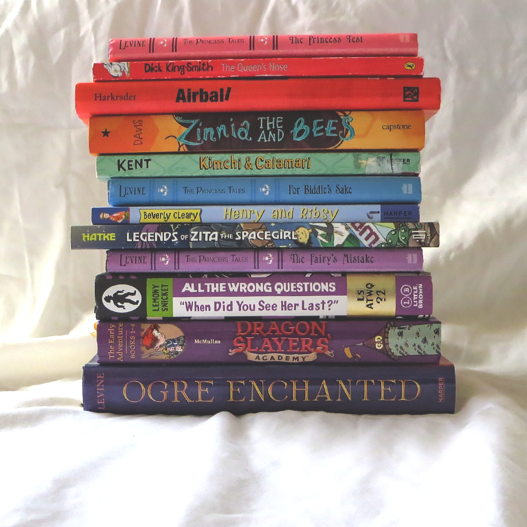 stack of books in rainbow order