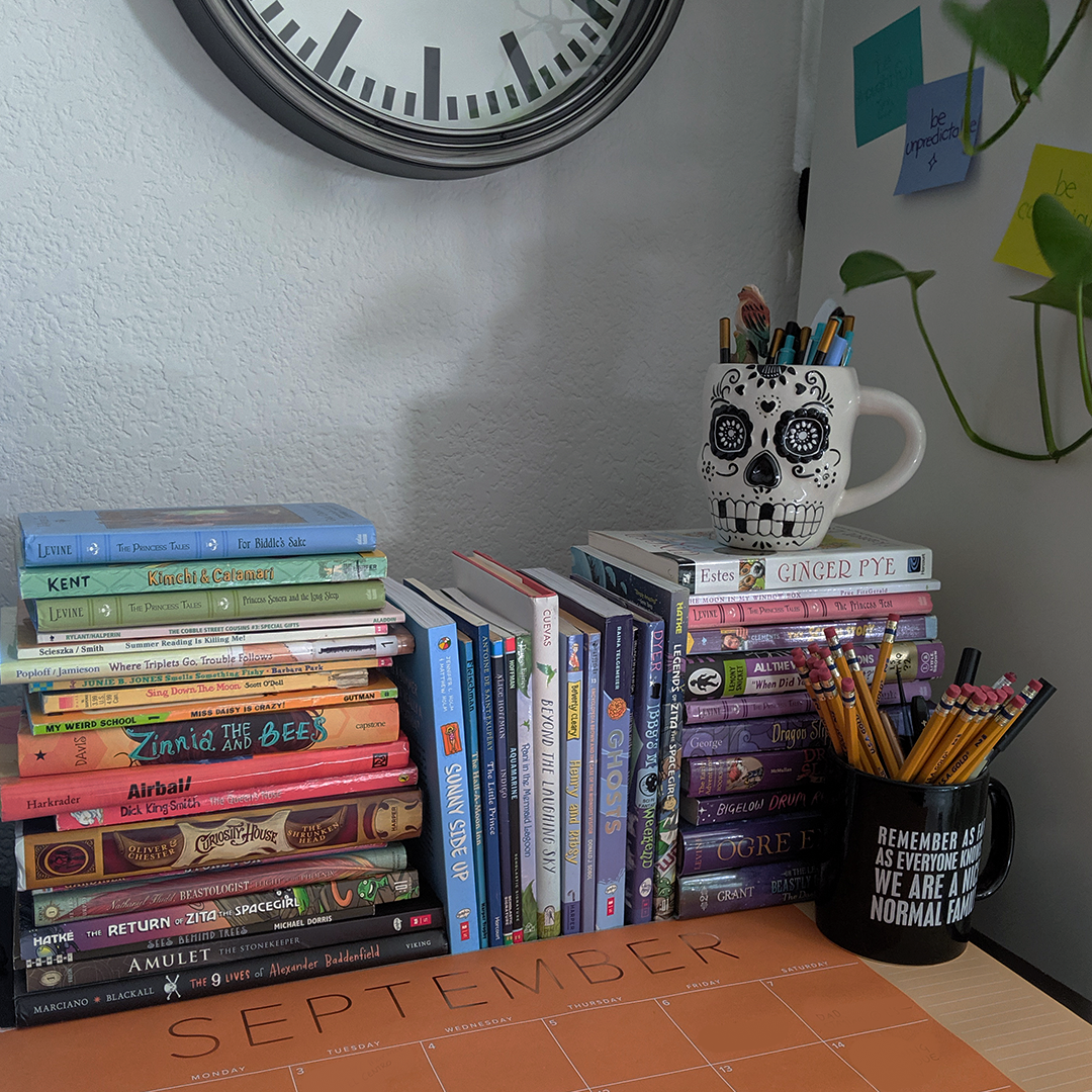 Workspace photo featuring books I've read and need to review