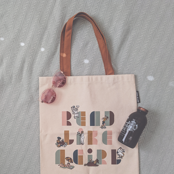"Photograph featureing ""read like a girl"" tote by Out of Print"