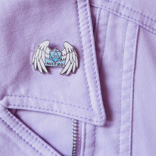 Enamel pin with a D20 with angel wings
