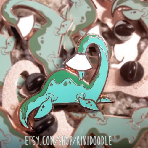 Loch Ness enamel pin from the Cone of Shame series by KikiDoodle