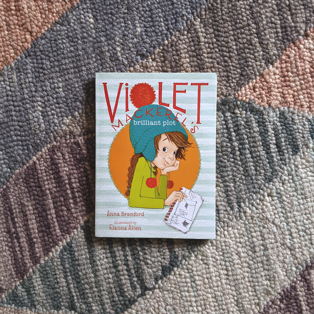 Photograph features the book VIOLET MACKEREL'S BRILLIANT PLOT by Anna Branford
